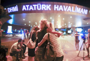 Passengers embrace each other at the entrance to Istanbul's Ataturk airport, early Wednesday, June 29, 2016 following their evacuation after a blast. Suspected Islamic State group extremists have hit the international terminal of Istanbul's Ataturk airport, killing dozens of people and wounding many others, Turkish officials said Tuesday. Turkish authorities have banned distribution of /images relating to the Ataturk airport attack within Turkey. (AP Photo/Emrah Gurel) TURKEY OUT